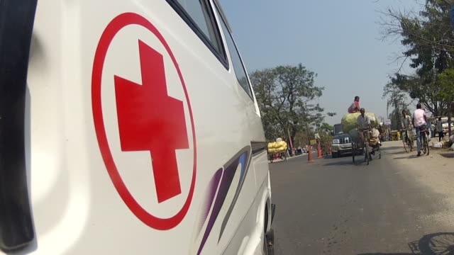 ambulance trip the view is from the side window to the back - tubercolosi video stock e b–roll