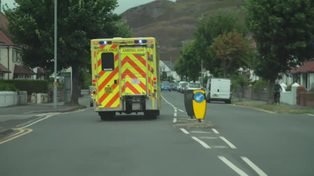 ambulance with sirens on driving along road, wales - flash stock videos & royalty-free footage