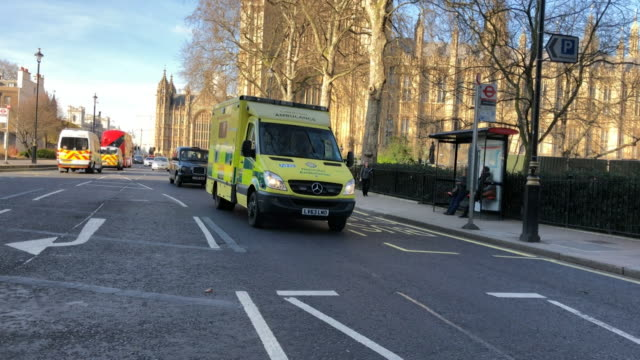 Ambulances and paramedic cars driving past the Houses of Parliament