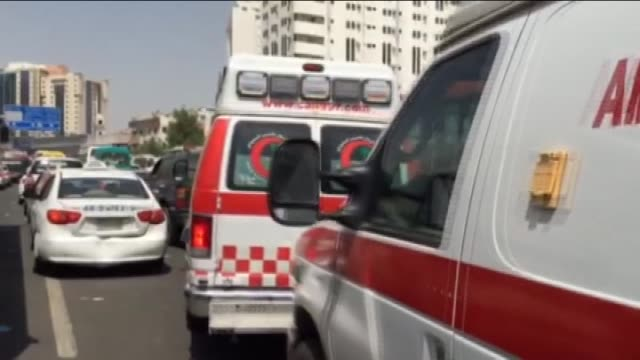 ambulances are seen on a road after at least 453 hajj pilgrims were killed – and another 719 injured – in a stampede that took place near the city of... - 2015 stock videos & royalty-free footage