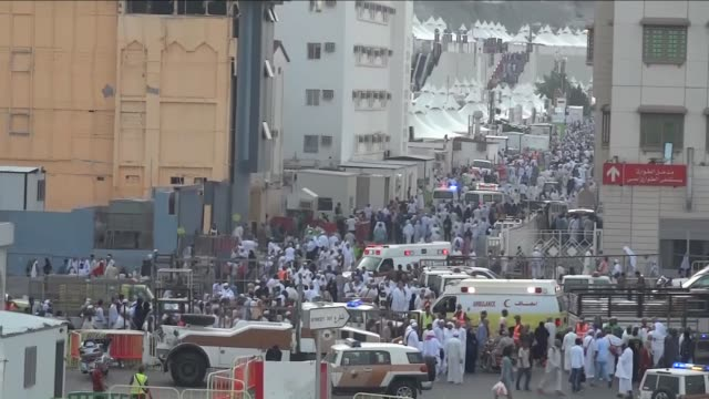 ambulances are seen on a road after at least 753 muslim hajj pilgrims were killed – and at least another 450 injured – in a stampede that took place... - stampeding stock videos & royalty-free footage