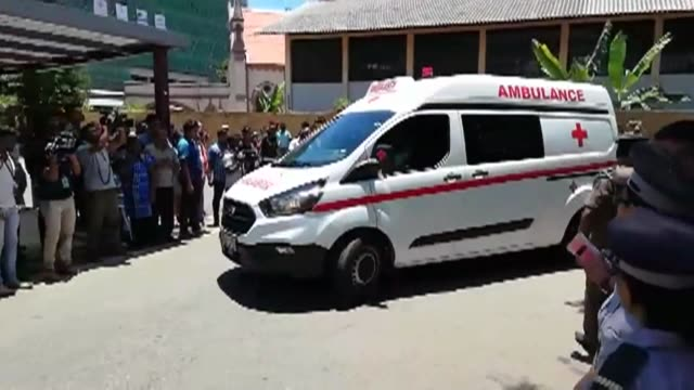ambulances arrive at a hospital in sri lanka's capital colombo after a string of bomb blasts hit churches and hotels in the city and the death toll... - sri lanka stock videos & royalty-free footage