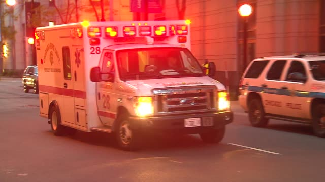 wgn ambulances driving toward the northwestern memorial hospital emergency entrance in june 15 2015 in chicago - einsatzsirene stock-videos und b-roll-filmmaterial