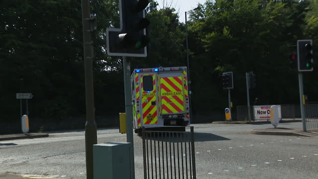 ambulances in glasgow, outside hospital and with sirens on - land vehicle stock videos & royalty-free footage