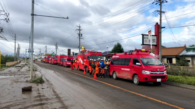 ambulances on the scene of damaged houses after being hit by typhoon hagibis on october 15 2019 in hoyasu near nagano japan japan has mobilised over... - nagano prefecture stock videos & royalty-free footage