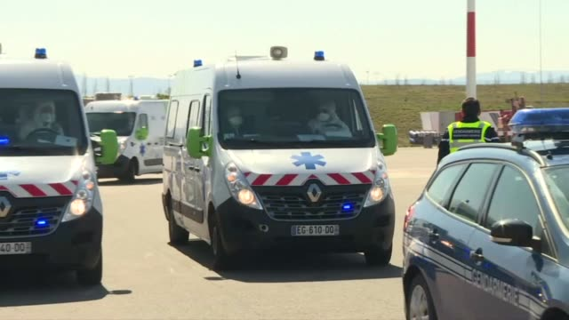 ambulances transporting six coronavirus patients who are to be evacuated wait for the arrival of a french air force airbus a330 phoenix on the tarmac... - report produced segment stock videos & royalty-free footage