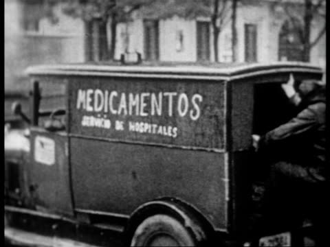 Ambulances transporting the wounded after fascist bombing / the only unbombed hospital in Madrid and the wounded being treated there
