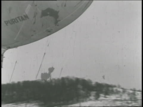 amelia earhart emerges from the goodyear blimp after landing. - 飛行船点の映像素材/bロール