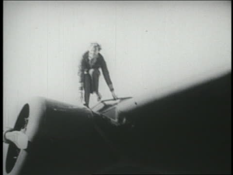 Amelia Earhart getting out of airplane slowly