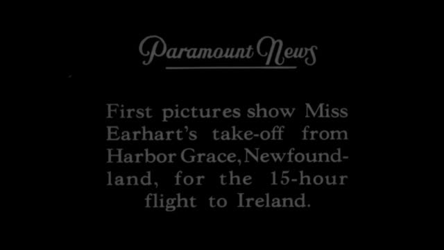 CU Amelia Earhart posing for photo opportunity / QS title card 'First pictures show Miss Earhart's takeoff from Harbor Grace [sic] Newfoundland for...