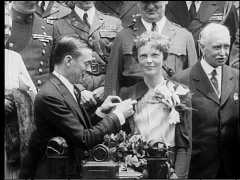 Amelia Earhart receiving a medal from NYC Mayor Walker after TransAtlantic flight