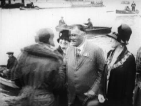 Amelia Earhart shaking hands with female Mayor Welch of Southampton England / newsreel