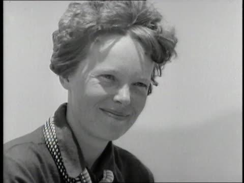 Amelia Earhart smiles