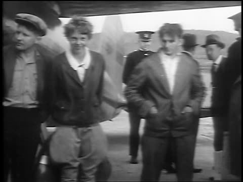Amelia Earhart with crew Stultz Gordon by plane / St John New Brunswick / newsreel