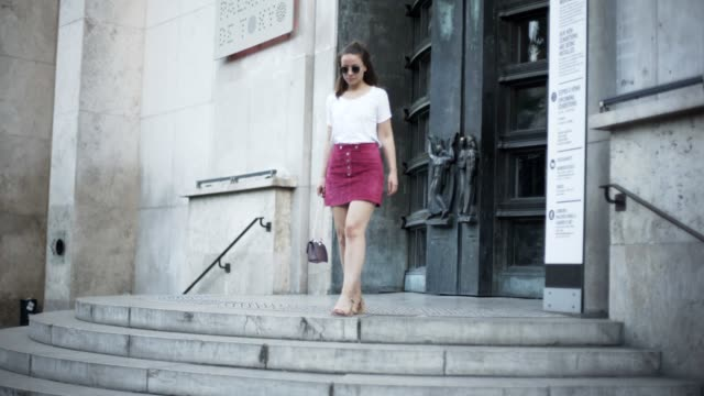amelie lloyd fashion blogger wears a courreges pink red velvet skirt a maison scotch white top a valentino rockstud bag and zara sandals at palais de... - amelie lloyd stock videos and b-roll footage