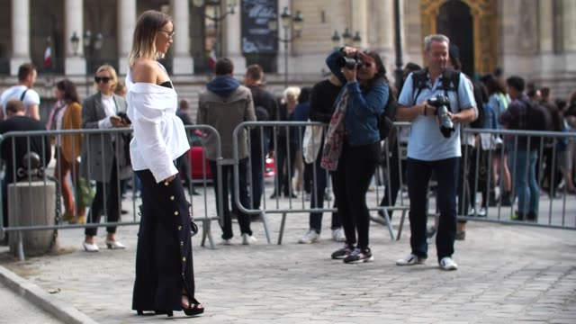 amelie lloyd is wearing zara pants a cos shirt a balenciaga bag and dior sunglasses outside the mugler show during paris fashion week spring summer... - amelie lloyd stock videos and b-roll footage
