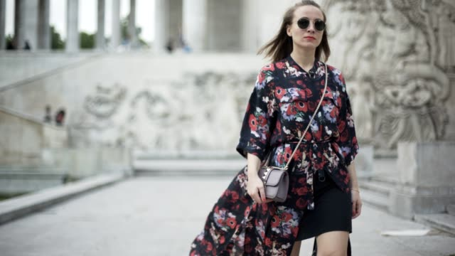 amelie lloyd wears a kenzo flower print kimono dress zara shoes sunglasses a valentino rockstud bag at palais de tokyo on may 30 2017 in paris france - amelie lloyd stock videos and b-roll footage