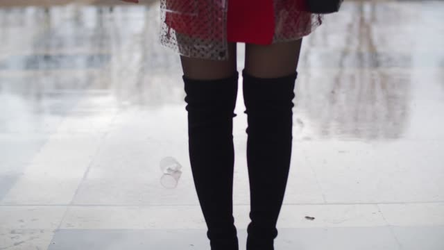 amelie lloyd wears newlook black thigh high boots a newlook red skirt a victoria beckham shirt a newlook raincoat and a furla bag outside the mashama... - amelie lloyd stock videos and b-roll footage