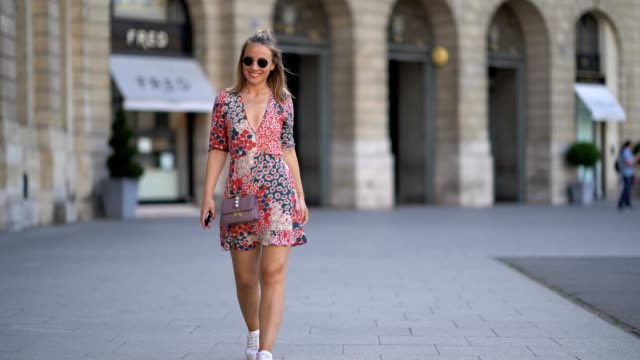 amelie lloyd wears rayban sunglasses a flower print dress from zara white sneakers and a valentino bag at place vendome on june 17 2017 in paris... - amelie lloyd stock videos and b-roll footage