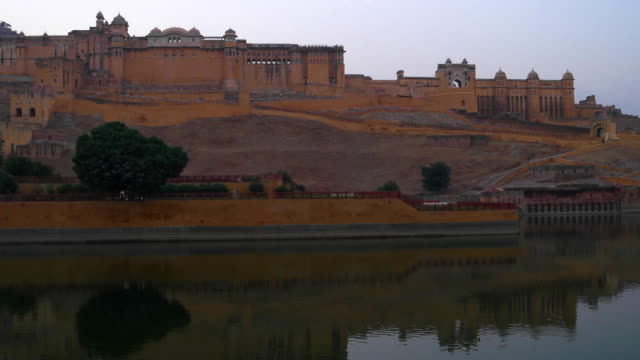 amer fort reflected in the maota lake, one of the major tourist attractions in rajasthan - fortress stock videos and b-roll footage