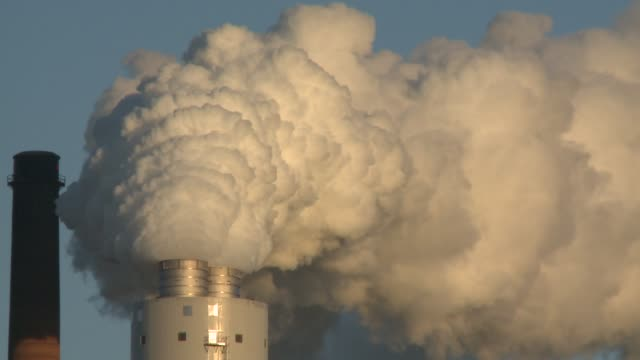 vidéos et rushes de ameren says some newly installed scrubbers cut sulfur dioxide emissions by 95 percent / various views of coal power plants pumping out steam and... - matière chimique