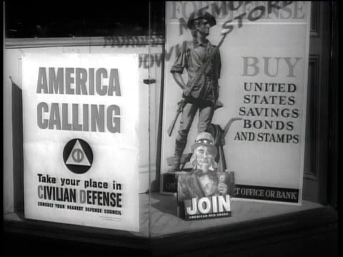 vídeos de stock, filmes e b-roll de america calling take your place in civilian defense / buy united states savings bonds - ação da bolsa de valores