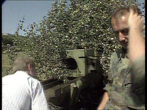 america threatens military action against serbs bosniaherzegovina sarajevo mount igman ms serbs artillery gun under camouflage netting lms ditto as... - sarajevo stock-videos und b-roll-filmmaterial