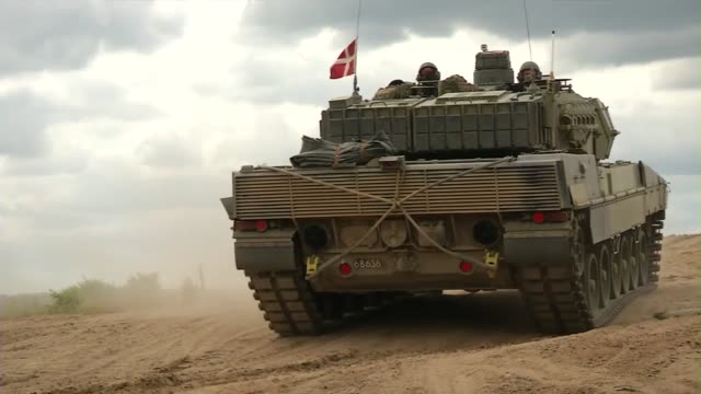 American Abrams Tanks and Danish Leopard Tanks participate in live fire exercise during Saber Strike