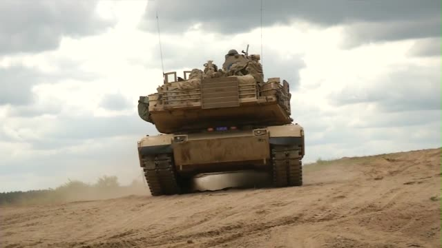 american abrams tanks and danish leopard tanks participate in live fire exercise during saber strike - kampfpanzer stock-videos und b-roll-filmmaterial