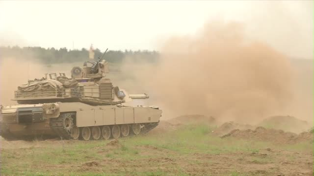 american abrams tanks and danish leopard tanks participate in live fire exercise during saber strike - 装甲車点の映像素材/bロール