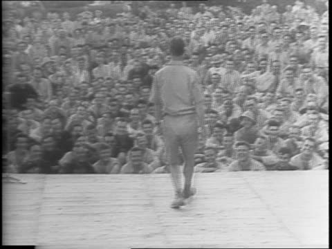 american actor and comedian joe e brown entertains troops in australia and new guinea / brown out of plane greeted by colonel sherr / brown and... - newsreel stock videos & royalty-free footage
