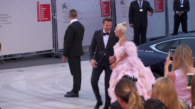 american actor and director bradley cooper and american singer and actress lady gaga arrive on the red carpet of 'a star is born' during the 75th... - lady gaga stock videos & royalty-free footage