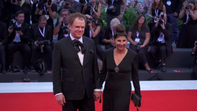 american actor john c reilly and his wife alison dickey arrive on the red carpet of 'the sisters brothers' during the 75th venice film festival on... - film festival stock videos & royalty-free footage