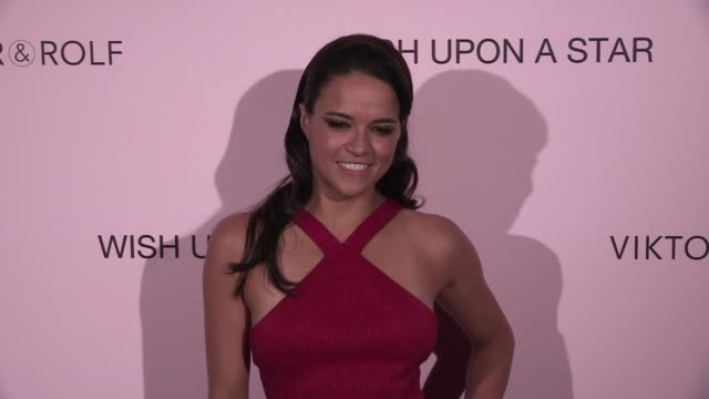 american actress michelle rodriguez wearing a red dress at viktor & rolf after party photocall at thianon in paris paris, france on wednesday july 8,... - 赤のドレス点の映像素材/bロール