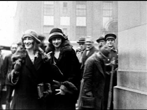 american actress peggy hopkins joyce on deck of ocean liner dressed in cloche hat fur coat vs british actress 'the countess of cathcart' standing w/... - 1921 stock-videos und b-roll-filmmaterial
