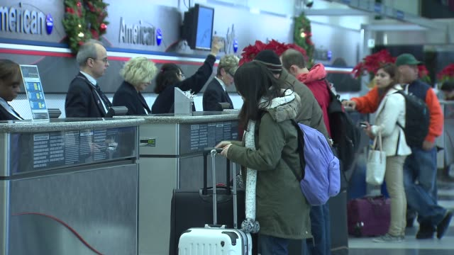 wgn american airlines airport checkin counter at chicago o'hare airport on december 20 2013 in chicago illinois - aeroplane ticket stock videos & royalty-free footage