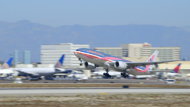 American Airlines Boeing-777 with Breast Cancer Awareness exterior graphics takes off from LAX