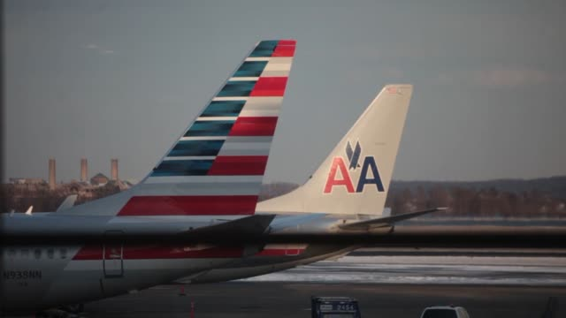 american airlines group inc planes including a boeing co 737823 center sit parked at gates at ronald reagan national airport in washington dc us... - columbia center stock videos & royalty-free footage