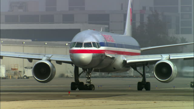 ms, american airlines jet taxiing in runway, los angeles, california, usa - airport runway stock videos & royalty-free footage
