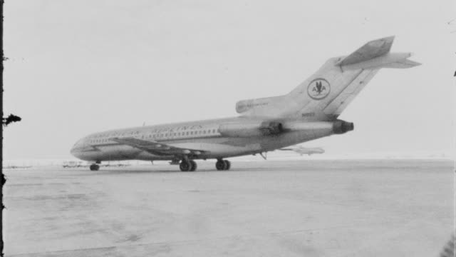 American Airlines opened a route from Nashville to Chicago in the early 1960s / American Airlines plane taxiing on runway car pulling up to AA...