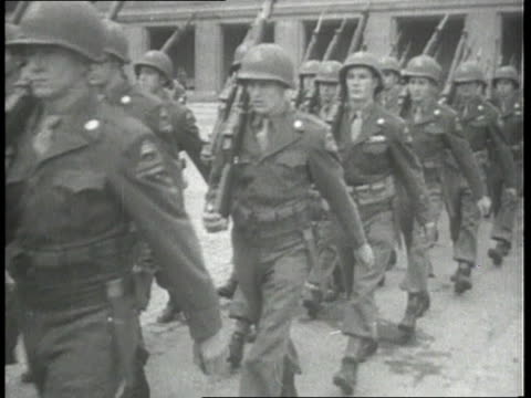vídeos de stock, filmes e b-roll de american american troops marching in two lines holding rifles over their shoulders / berlin germany germany - 1945