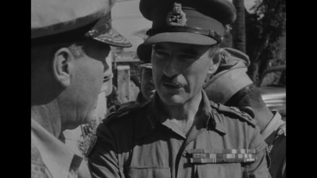 american and british military men chatting second officer muriel price secretary to british maj gen sir w r c penney / asian military person enters... - japanese surrender stock videos & royalty-free footage