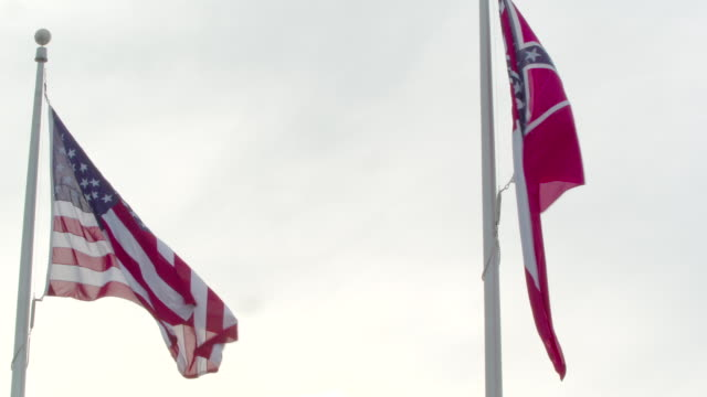 american and confederate flags fly side by side in jackson, medium shot - jackson stock videos & royalty-free footage