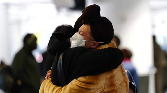 american and delta airlines halt china flights due to coronavirus the us is funneling flights from china to the us to seven airports to help contain... - embracing stock videos & royalty-free footage
