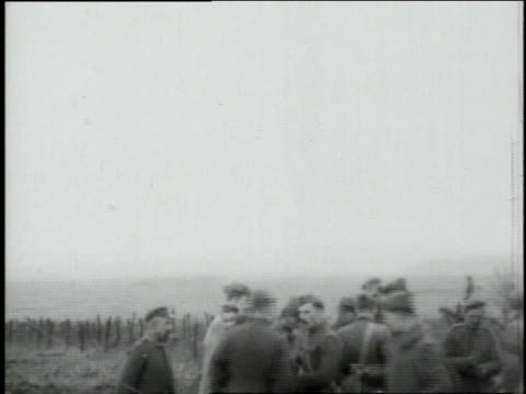 American and German soldiers meet in No Man's Land after Armistice shaking hands smiling and posing / Dampvitoux MeurtheetMoselle France