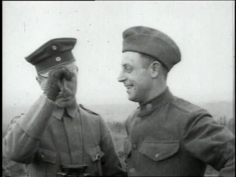 American and German soldiers trading hats and smiling / Dampvitoux MeurtheetMoselle France