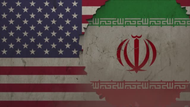 american and iran flags on the stone wall stock video - agreement stock videos & royalty-free footage