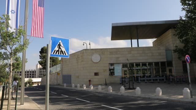 american and israeli flags fly at the entrance to the new american embassy in jerusalem which is scheduled to open next week on may 9, 2018 in... - jerusalem stock videos & royalty-free footage
