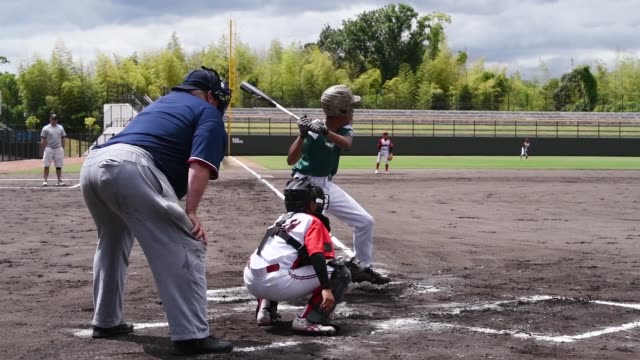 american and japanese children play baseball with each other during a tournament at atago's kizuna stadium in iwakuni japan - japanese ethnicity stock videos & royalty-free footage