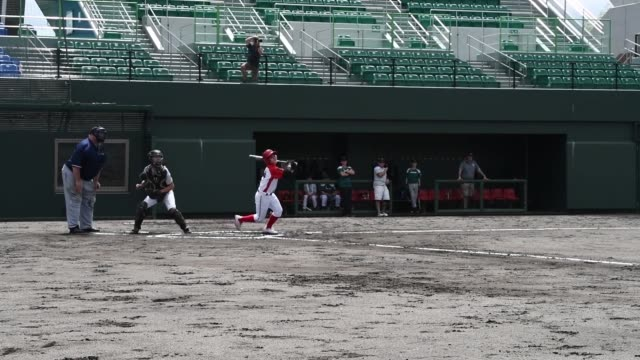 american and japanese children play baseball with each other during a tournament at atago's kizuna stadium in iwakuni, japan. - スポーツ用語点の映像素材/bロール